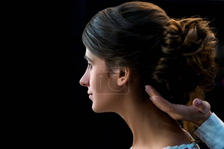 hairdresser doing hairstyle