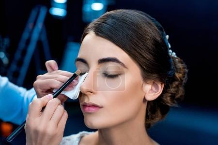 Makeup artist applying eye shadows