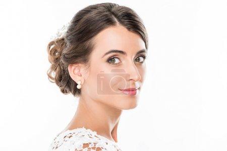 Foto de Retrato de tierna mujer sonriente mirando a cámara aislada en blanco - Imagen libre de derechos