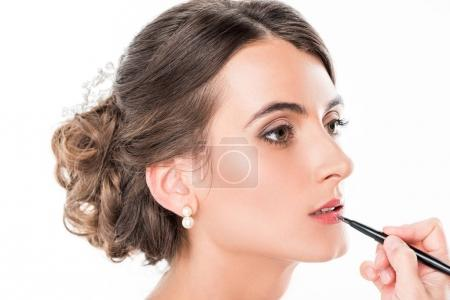 Photo for Partial view of makeup artist applying lipstick on model using lip brush isolated on white - Royalty Free Image