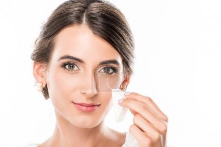 Woman with makeup sponge in hand