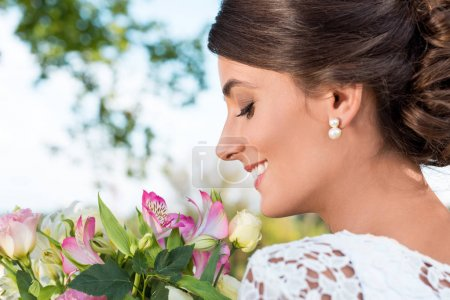 tender woman with bouquet of flowers
