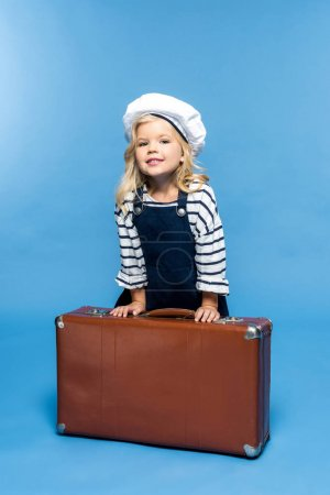 adorable child with suitcase
