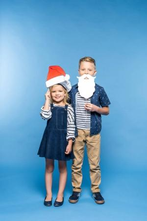 kids with santa hat and fake beard