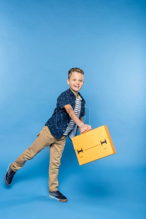 boy with paper briefcase