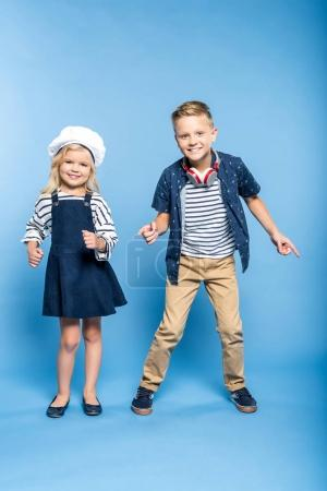 Photo for Adorable little girl and boy dancing and smiling at camera - Royalty Free Image