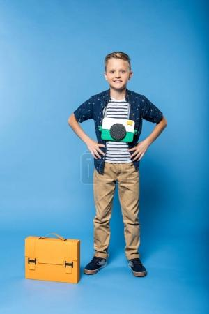boy with briefcase and camera