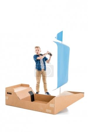 Boy playing with boat