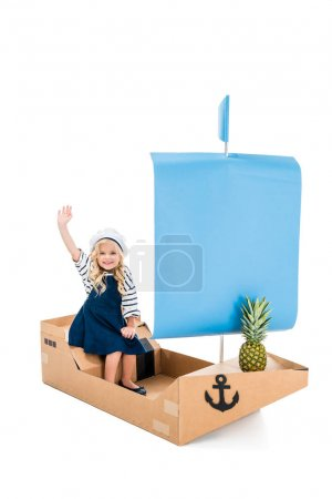 child playing with boat
