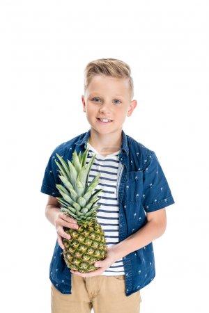 boy holding pineapple