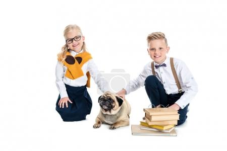Children stroking dog
