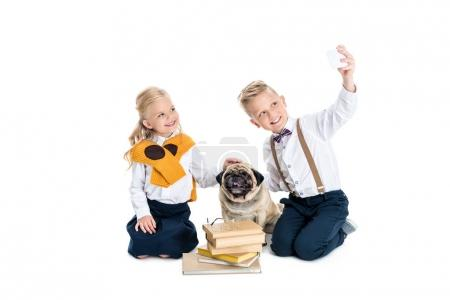 kids with dog taking selfie