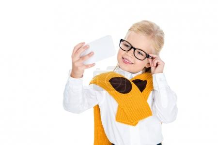 child taking selfie with smartphone