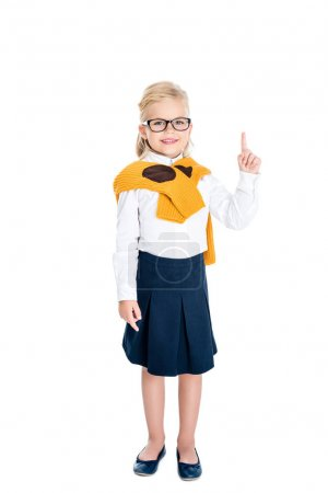 child pointing up with finger