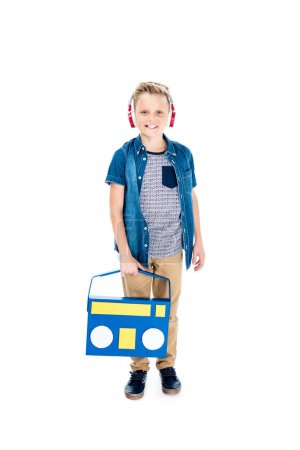 boy listening music in headphones