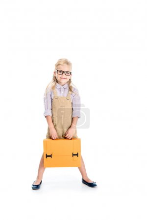 child in eyeglasses with briefcase