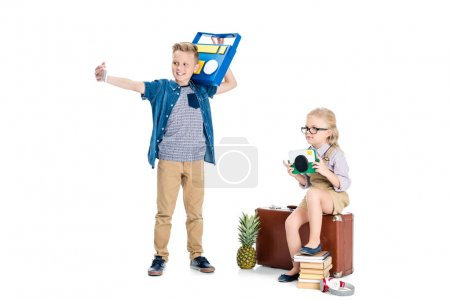 Kids taking selfie with various objects