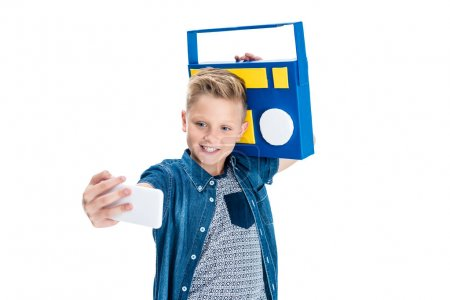 Boy with tape recorder taking selfie