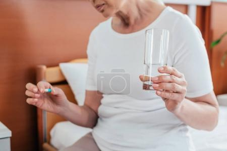 senior woman taking medicine