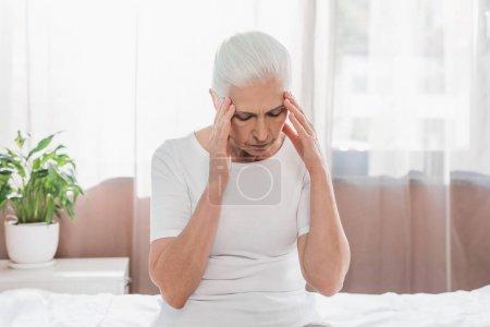upset senior woman in hospital