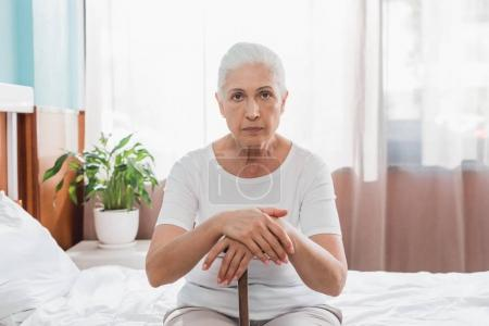 senior woman with cane in hospital