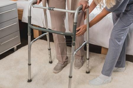 Photo for Cropped shot of nurse helping senior patient with walker - Royalty Free Image