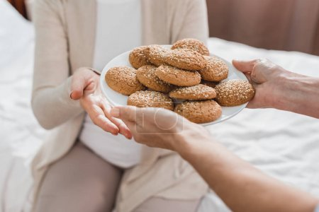 nurse and patient with cookies
