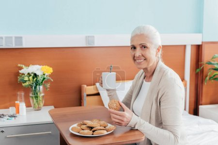 senior woman eating in hospital