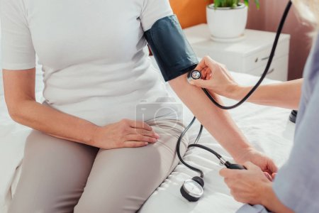nurse measuring blood pressure to patient