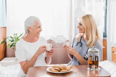 nurse and patient drinking tea