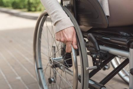 Photo for Close-up partial view of senior woman sitting in wheelchair - Royalty Free Image