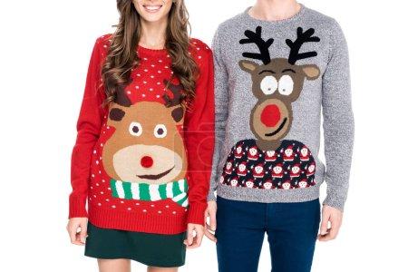 couple in winter festive sweaters