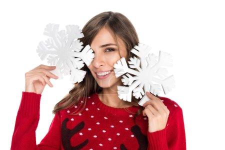 woman holding snowflakes