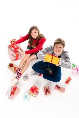 couple sitting among christmas gifts