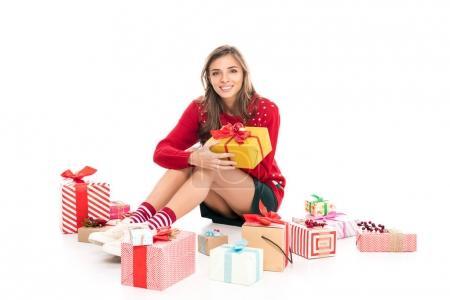 woman sitting among christmas presents