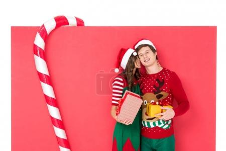couple in santa hats with gifts