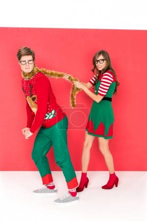 couple in christmas costumes having fun