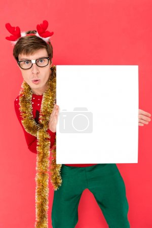 Man in sweater with blank banner
