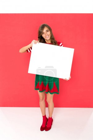 woman in elf costume with banner