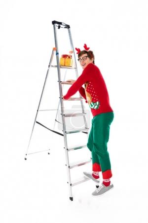 Man going up on ladder for gifts