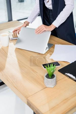 businesswoman closing laptop
