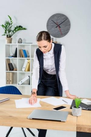 Businesswoman looking at paperwork