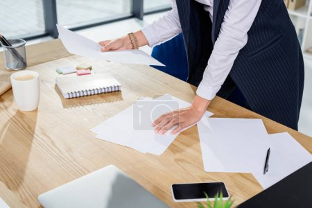 businesswoman reading at paperwork