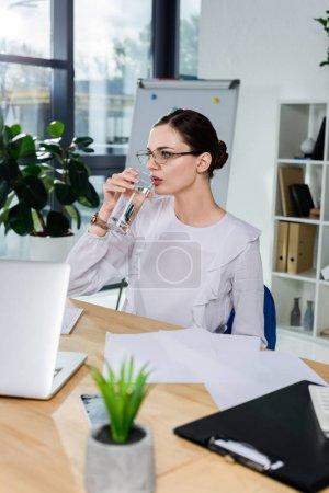 businesswoman drinking water