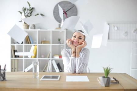 Cheerful businesswoman at desk in office