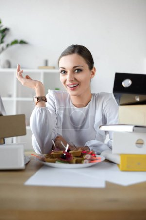 businesswoman with plate of sandwiches