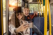 couple taking selfie in public transport