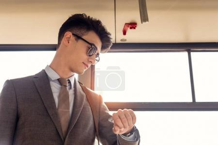 man checking time