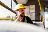 worker talking on smartphone