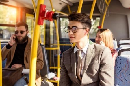 man in eyeglasses in bus